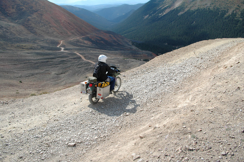 Larry leaving Webster, with full luggage option,a grand view, and a steep rocky trail downhill ahead...