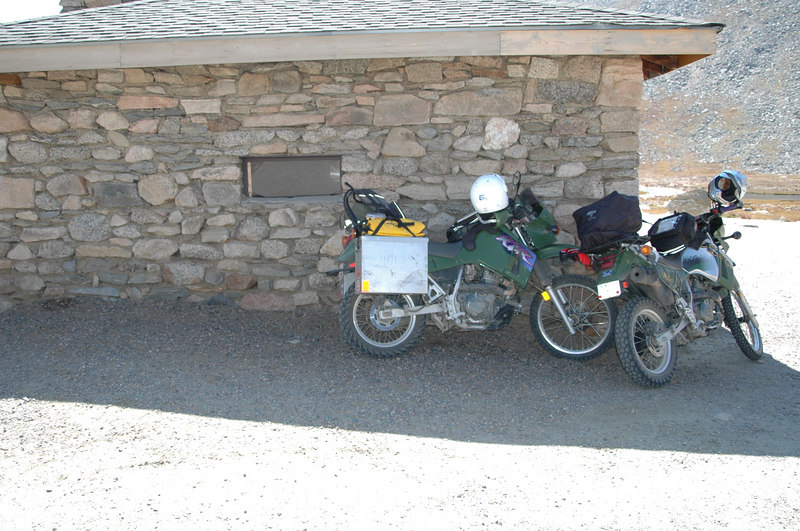 The winds at Summit Lake on Mt Evans blew larrys bike over so we had to lean them against a small building to keep them upright...