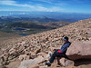Every trip to Pikes Peak, I walk over to the same rocks near the weather station and sit for 15 minutes and look at the beauty of this place...Cripple Creek is in the distance past the first smaller mountain range
