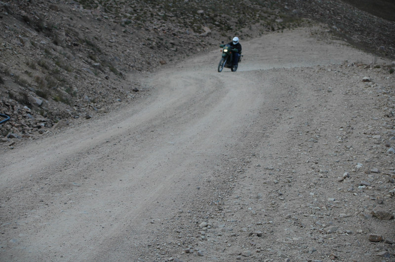 Larry heads up a switchback at Jones Pass road