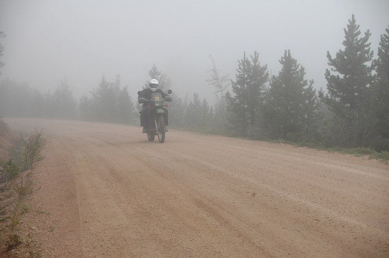 Larry riding down Rampart Road in the cool mist
