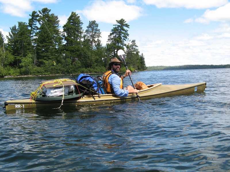 Packing out trash from the pristine Boundary Waters.<br /> Dom.