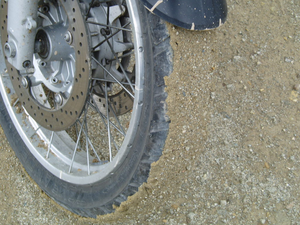 Rained the previous evening making for muddy gravel roads.