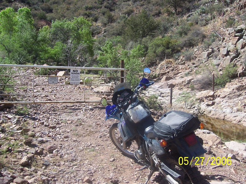 Here is my bike at the same spot a week later.  The sign said there was aerial suveillance and motion cameras and video cameras hidden along the path.  Seemed far-fetched but it was none-the-less clear that we were not wanted.  This gate is just a few hundred yards before the 'Gatekeeper' rock formation in the trail.