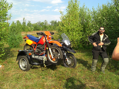 What has three cylinders, five wheels and is orange and black?  A GS sidecar hauling a Honda XR350!  Cool factor: 9.3!