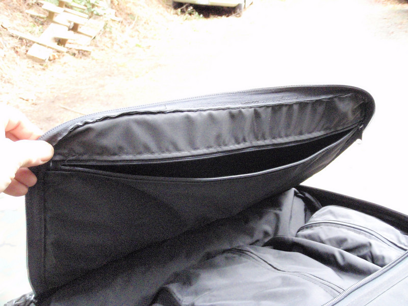 This shows the zippered pocket on the inside of the top cover, it is used to store articles you want quick access too or the rain cover, shoulder strap etc.