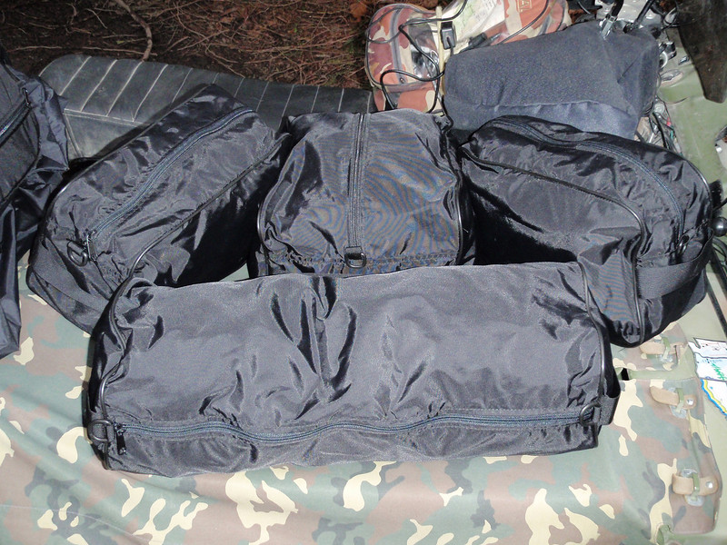 This shows the four inner bags, the long one in the front fits across the front of the bag, the large one in the middle is half the width of the main bag, the two smaller bags are one forth the width of the main bag.  All these bags come with carry handles on each end.