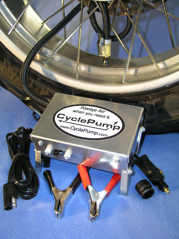"""The new CyclePump ADVENTURE model CyclePump sets the new Gold Standard for motorcycle tire inflators.  It can connect to BMW, SAE, cigarette outlets, and the battery clips can be attached to any 12 volt battery.  There's a second 8-foot power cord for emergency automotive applications.  The aluminum case measures only 2""""x4""""x6"""".  Folding legs add stability and keep the case out of the dirt or mud.  $100"""