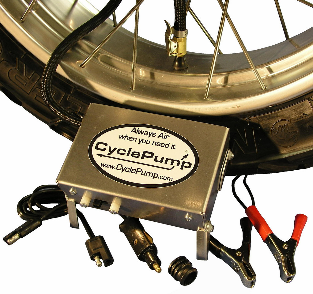 "The new CyclePump ADVENTURE model CyclePump sets the new Gold Standard for motorcycle tire inflators.  It can connect to BMW, SAE, cigarette outlets, and the battery clips can be attached to any 12 volt battery.  There's a second 8-foot power cord for emergency automotive applications.  The aluminum case measures only 2""x4""x6"".  Folding legs add stability and keep the case out of the dirt or mud.  $100"