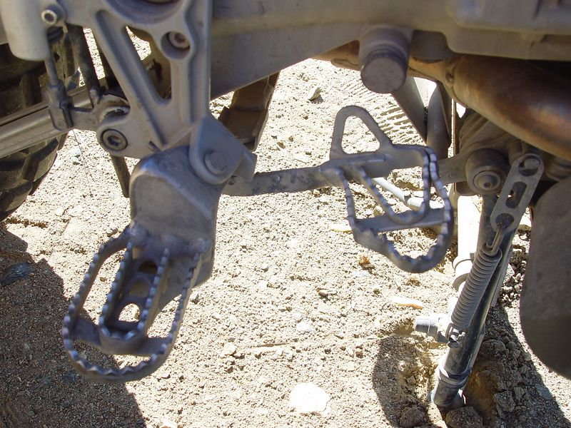 Here is the rear brake pedal after I took it off and repaired it by hammering it straight with my hatched using a large rock as an anvil.  One of the many trail side repairs I made or assisted in during this ride.