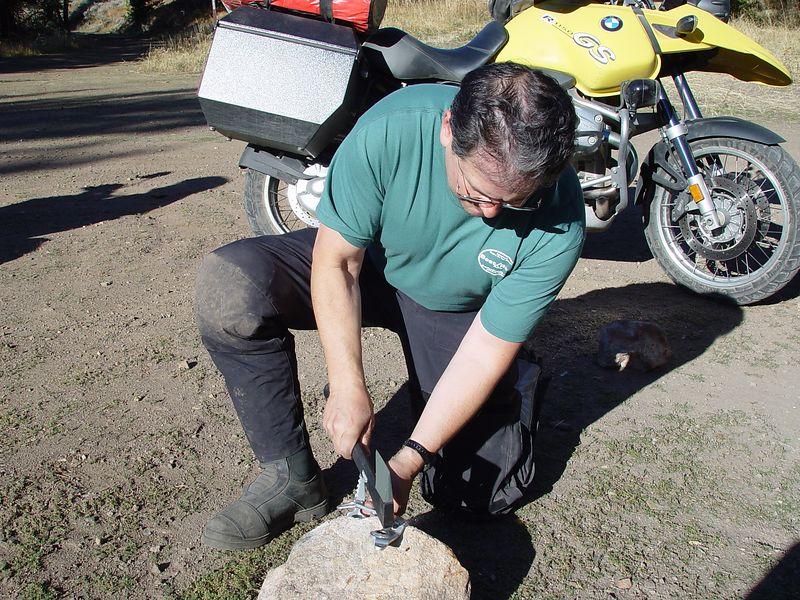 Dave using my hatchet to straighten his brake pedal.