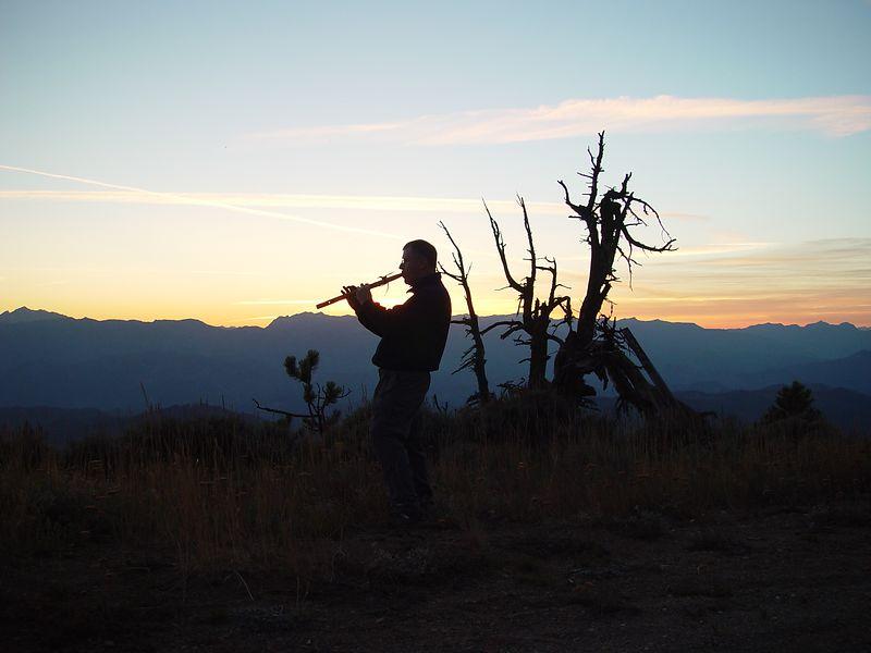 Steve plays his flute at sun set.