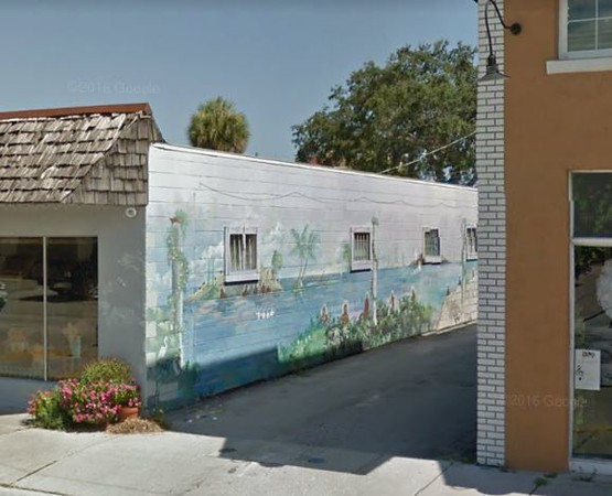Alley approx 581 W Eau Gallie Blvd, between Highland Ave and Guava Ave.