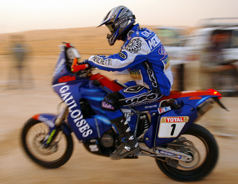 Italian Fabrizio Meoni on his KTM speeds 07 January 2003 covering the sixth stage of El Borma in Tunisia and Ghadames in Libya of the current Dakar motor-rallying contest. Meoni finished the stage fourth and stood third overall.