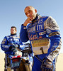 Italian Fabrizio Meoni (R) on his way to refill his KTM as French Cyril Despres looks on 11 January 2003 in the Libyan desert during the tenth stage Zilla-Sarir (Libya). Meoni rode 300km with one cylinder and finishes 41 minutes behind the stage winner. Meoni takes the third place in the overall lead.