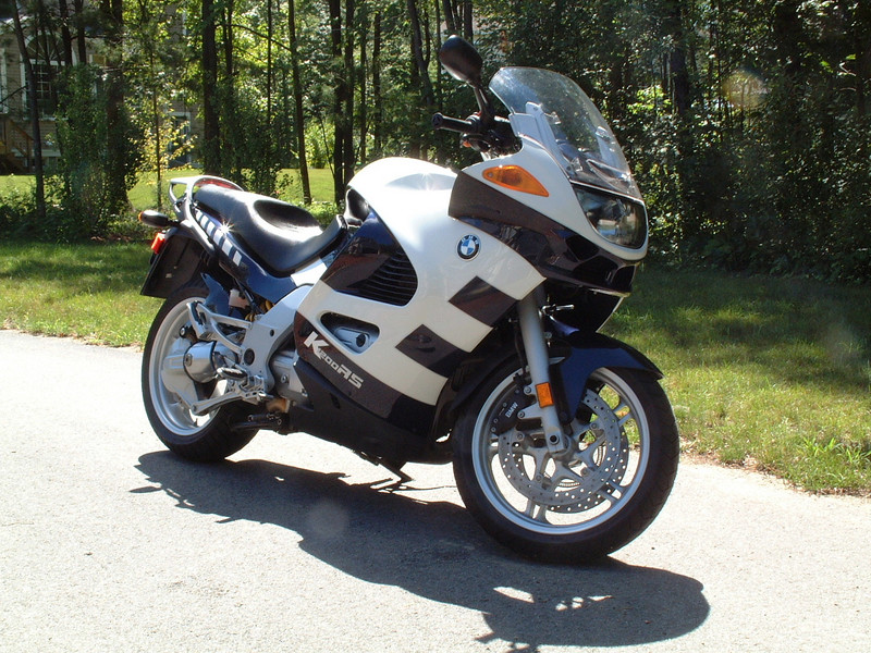 The 2004 K1200RS was sleek, fast, and sophisticated.  130 HP at the crank, shaft drive, ABS, paralever/telelever suspension, beautiful bits.  It had sluggish handling until you hit 60 mph, and only woke up at 80 mph.
