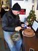 Ed Ovshak ices a cake.