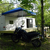 Honz bought this old FEMA trailer and had the deck built this spring.  It sleeps 5 or 6 and has a full size fridge and full bathroom.  But there is no electricity or sewer to the property!