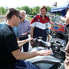 Teach explains to Honz and Dave Hunter how the K1600GTL accelerates and decelerates on its own when doing tight turns.  You don't even need your hands on the bars (recommended, though, if you aren't Teach McNeil).