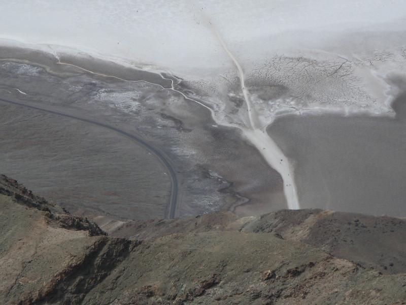 Closeup shows people walking on the salt.