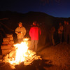 The campfire crowd gathers to enjoy time together into the night.