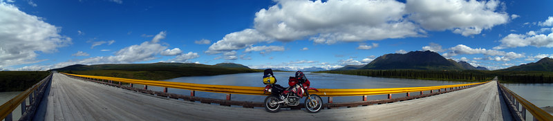 Wooden one lane bridge over the Susitna River. 7 shot panorama, 190 degree angle of view.