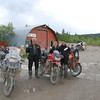 """Scott, Kristine and John celebrate with their """"Dempster flasks"""" - 1100 kms. round trip, past the Arctic Circle to Fort McPherson, NWT and back to Klondike River Lodge - Dempster Highway Mile 0"""