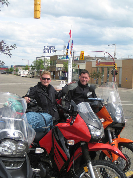 Kristine and John at Mile 0 of the Alaska Highway, Dawson Creek, B.C.