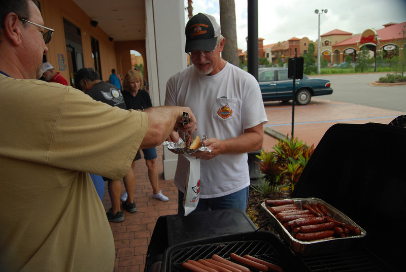 14 Serving hot dogs at J&P Cycles Super Store in Destination Daytona in Ormond Beach