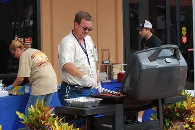 01 Bob and Carol making hotdogs for 2 Wheel Tuesday at J&P Cycles Destination Daytona