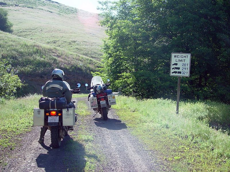 We are now going into an area the locals warned us to stay out of, they said our bikes were too big to travel this road and that we would get stuck in the middle of now-where.  We didn't Liston, we took this road and had a wonderful time.  From this point until we again found a paved road it was 48 miles, up and down ridges and across the high prairie.