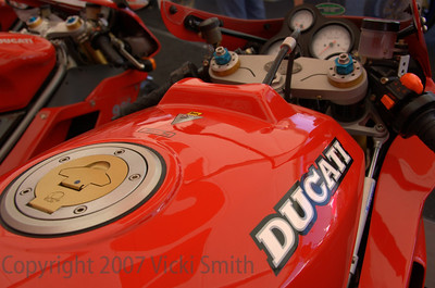 "From the bike description card: his is an original, unrestored 1992 Ducati 888 SP4.  The ""SP"" designation signifies ""Sport Production,"" a limited series of race inspired, and race tuned bikes designed to meet racing homologation  requirements.  The SP4 was reported to make 111 horsepower at 10,500 RPM, and was produced in a limited run of 500 bikes worldwide, none of which were ever designated for US distribution or importation.  The SP4 was the only 888 to display the distinctive ""#1"" insignia on the side panels, commemorating the racing dominance of the Ducati 888 bikes in World competition the prior years.  This is one of only two or three known street legal models in the United States, #475/500 as designated by the steering head plaque, and with less than 2300 original Km (not miles).  It was aquired from a private collector in 2005 and has been maintained in its pristine and ""display-only"" condition."