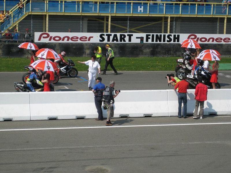 Paul at start position number 5 on the grid, in the shade of a pit babe