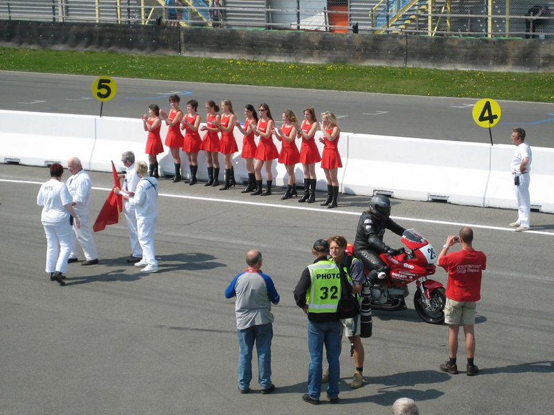 Pit babes welcoming riders back after a race