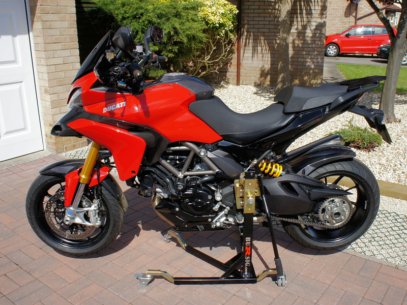 """<p>Bursig Motorcycle Side Lift Stand for the Multistrada 1200 - <b><a target=""""_blank"""" href=""""http://www.motorcycleinfo.co.uk/index.cfm?fa=contentGeneric.xijqbtkwbucbcvcu&pageId=5148005"""">See HERE</a></b></p> 13/16: Bike up on the stand"""