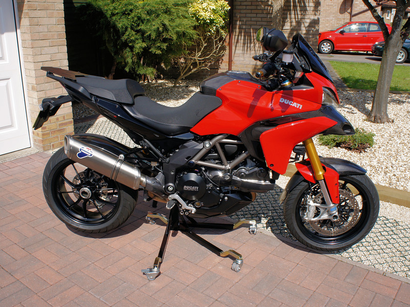 "<p>Bursig Motorcycle Side Lift Stand for the Multistrada 1200 - <b><a target=""_blank"" href=""http://www.motorcycleinfo.co.uk/index.cfm?fa=contentGeneric.xijqbtkwbucbcvcu&pageId=5148005"">See HERE</a></b></p> 15/16: Bike up on the stand"
