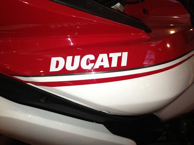 2013 Pikes Peak -  the Ducati decal is on the top of the side piece - on my 2010 the name is below the crease line and is bigger. Also note that some of the pikes peak pics show a gold pin stripe. This is not an original pikes peak, but a dressed up touring.