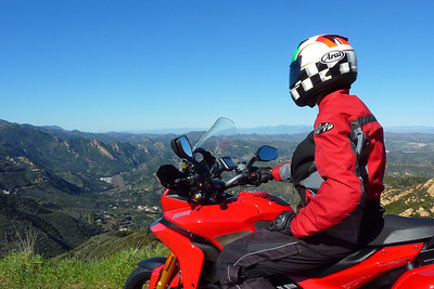 1/2 Photo of Ducati.ms member 'U235Power' (aka Chip) admiring the view - what a day, first day of ownership of the Multistrada 1200, superb weather, great roads, amazing scenery....what more can a man want?! This picture with me looking off in the distance is on Piuma Rd. in Malibu, CA in the Santa Monica Mountains… I'm facing NE toward Calabasas and Thousand Oaks. Multistrada 1200 Info Resources: www.MTS1200.info