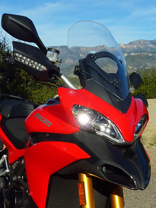 2/2 Photo of Ducati.ms member 'U235Power' (aka Chip) admiring the view - what a day, first day of ownership of the Multistrada 1200, superb weather, great roads, amazing scenery....what more can a man want?! This picture of the front of the bike alone is off Hwy 154, NW of Santa Barbara, CA.  Both shots were taken on the ride home from getting the bike in Newport Beach. Multistrada 1200 Info Resources: www.MTS1200.info
