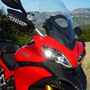 2/2 Photo of Ducati.ms member 'U235Power' (aka Chip) admiring the view - what a day, first day of ownership of the Multistrada 1200, superb weather, great roads, amazing scenery....what more can a man want?! <i>This picture of the front of the bike alone is off Hwy 154, NW of Santa Barbara, CA.  Both shots were taken on the ride home from getting the bike in Newport Beach.</i> <b>Multistrada 1200 Info Resources: www.MTS1200.info</b>