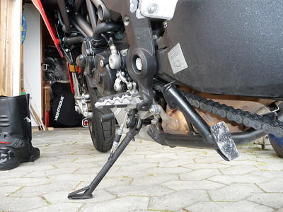 Even more drastically modified Multistrada 1200 centrestand to avoid 'snagging' the heal of your boot. AshOnBikes / www.Ducati.MS forum member 'pdm-dk' ....cut off the little crossbar in both ends, cut off some more of the pipe, and rewelded it all, and painted  More info here