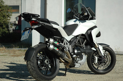QD twin silencer exhaust system for the Multistrada 1200 - carbon cans shown here but Titanium optional available also:  http://www.qdexhaust.it/english/news.html  See: Multistrada 1200 Exhausts Systems & Exhaust Modifications   http://www.motorcycleinfo.co.uk/index.cfm?fa=contentGeneric.qsconequekcvtgsq&pageId=2227905