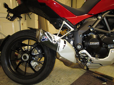 Multistrada 1200 Termignoni carbon stubby exhaust vs... (see previous / next photo)  See: Multistrada 1200 Exhausts Systems & Exhaust Modifications   http://www.motorcycleinfo.co.uk/index.cfm?fa=contentGeneric.qsconequekcvtgsq&pageId=2227905