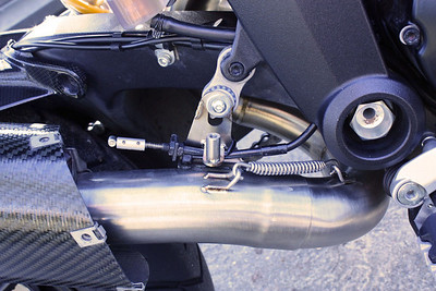 MIVV decat pipe D.027.C1 (now D.027.C3) http://www.mivv.it/en MIVV's solution for the exhaust valve control cable after removal of the OE exhaust CAT box with the butterfly valve (the ally lug clamped to the cable)  See: Multistrada 1200 Exhausts Systems & Exhaust Modifications  http://www.motorcycleinfo.co.uk/index.cfm?fa=contentGeneric.qsconequekcvtgsq&pageId=2227905
