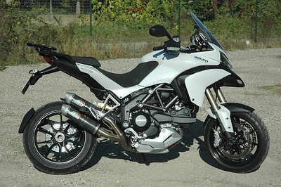 QD (Quad-D) twin silencer exhaust system for the Multistrada 1200 - carbon cans shown here but Titanium optional available also:  http://www.qdexhaust.it/english/news.html  See: Multistrada 1200 Exhausts Systems & Exhaust Modifications   http://www.motorcycleinfo.co.uk/index.cfm?fa=contentGeneric.qsconequekcvtgsq&pageId=2227905
