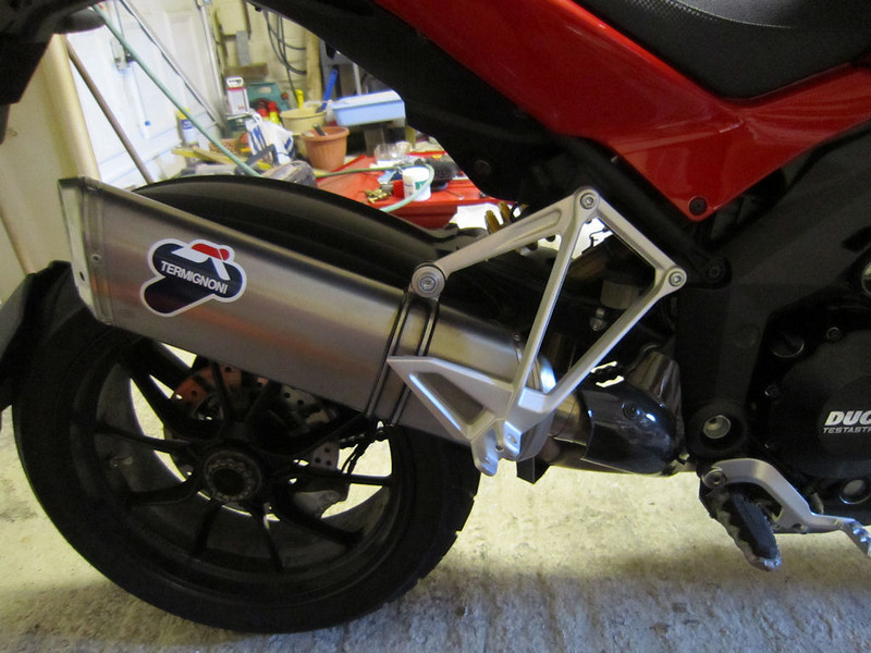 """Multistrada 1200 full Termignoni exhaust system, titanium end can vs... (see previous photo)<br /> <br /> See: Multistrada 1200 Exhausts Systems & Exhaust Modifications <br />  <a href=""""http://www.motorcycleinfo.co.uk/index.cfm?fa=contentGeneric.qsconequekcvtgsq&pageId=2227905"""">http://www.motorcycleinfo.co.uk/index.cfm?fa=contentGeneric.qsconequekcvtgsq&pageId=2227905</a>"""