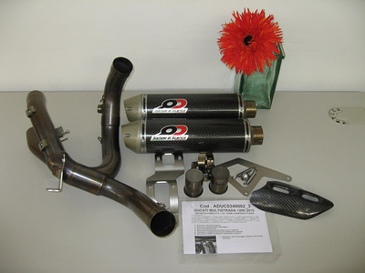 QD (Quad-D) twin silencer exhaust system for the Multistrada 1200 - carbon cans shown here but Titanium optional available also:  http://www.qdexhaust.it/english/news.html (photo by ducati.ms member 'ducati bruce') ....note the two optional mini CAT / baffle inserts. See: Multistrada 1200 Exhausts Systems & Exhaust Modifications   http://www.motorcycleinfo.co.uk/index.cfm?fa=contentGeneric.qsconequekcvtgsq&pageId=2227905