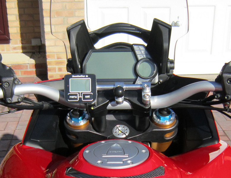 """Multistrada 1200 (AndyW) - 'GadgetGuy'  handlebar centre GPS / SatNav RAM mount See  <b>http://www.MTS1200.info</b> for GPS mounts and installation ideas ;-) <b><a target=""""_blank"""" href=""""http://www.motorcycleinfo.co.uk/index.cfm?fa=contentGeneric.psqlmptrfsppjcbe&pageId=4958724#gps_mount"""">AndyW's Multistrada 1200 GPS / SatNav mount</a></b>    <p><b><a target=""""_blank"""" href=""""http://www.motorcycleinfo.co.uk/index.cfm?fa=contentGeneric.zvfiihryhlqbrzht&pageId=1214516"""">Ducati Multistrada 1200 MTS1200 GPS / Sat Nav (SatNav) Info</a></b></p>"""