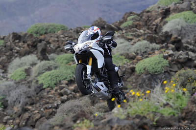 Ducati Multistrada 1200 / MTS1200 - wheelie! - another really cool shot!   See: Multistrada 1200 Info & Resources