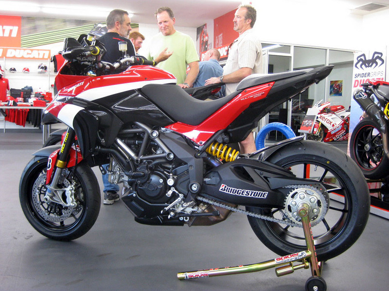 """www.asphaltandrubber.com <i>We were lucky enough today to get some shots from an Asphalt & Rubber reader who was in attendance at the Newport Beach Ducati shop to check out the Pikes Peak Ducati Multistrada 1200S race bike.</i> mts1200.info article <b><a href=""""http://www.motorcycleinfo.co.uk/index.cfm?fa=contentGeneric.svujwmxokbhbwyoc&pageId=1209402"""">HERE</a></b>"""